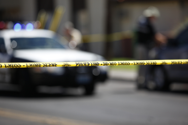 Las Vegas police investigate the scene where a women was shot on the 1000 block of Sierra Vista Drive, near Maryland Parkway and Desert Inn Road, in Las Vegas on Wednesday, Sept. 3, 2014. The woma ...