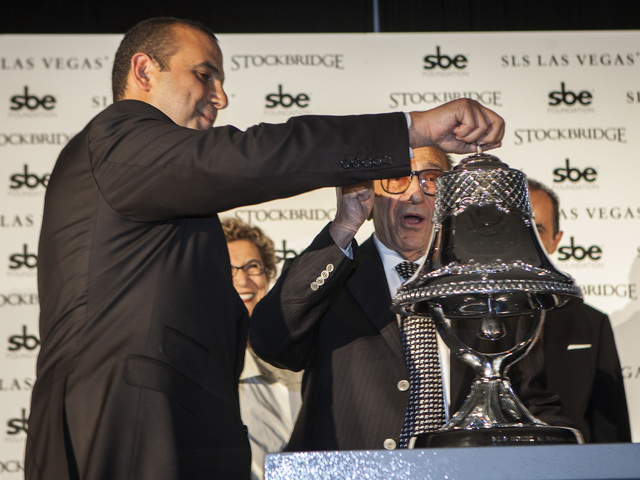 Sam Nazarian, left, CEO of SBE Entertainment,  and his father Younes during the ceremonial ringing of the bell at  SLS Las Vegas  on Friday Aug. 22, 2014. (Jeff Scheid/Las Vegas Review-Journal)