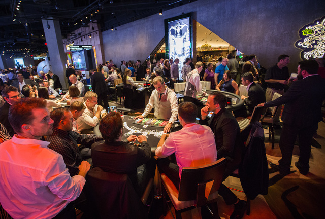 Gamers play table games shortly after midnight at SLS Las Vegas  on Saturday, Aug. 23, 2014. The $415 million  development on the corner of Sahara Avenue and Las Vegas Boulevard opened today.(Jeff ...