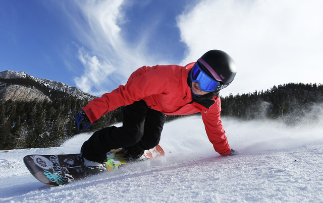 Professional snowboarder Amanda Propst leans into a turn as she makes her way down a run at the Las Vegas Ski and Snowboard Resort on Mount Charleston, Jan. 2, 2013. (Jason Bean/Las Vegas Review-J ...