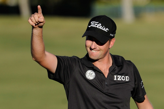 Webb Simpson celebrates after making birdie on the 18th hole on his way to a six-stroke victory during the final round of the Shriner Hospital for Children Open at TPC Summerlin in 2013. Simpson w ...