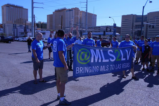 Pro soccer stadium fans gather in a parking lot near Las Vegas City Hall in Las Vegas on Wednesday, Sept. 3, 2014, before the Las Vegas City Council vote on a potential deal for a stadium. (Alan S ...