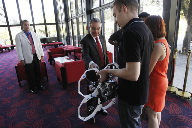 UNLV President Don Snyder talks with Greg Friesmuth after Friesmuth flew his remote-controlled quad drone during the annual state of UNLV address Thursday, Sept. 18, 2014 in UNLV's Judy Bayley The ...