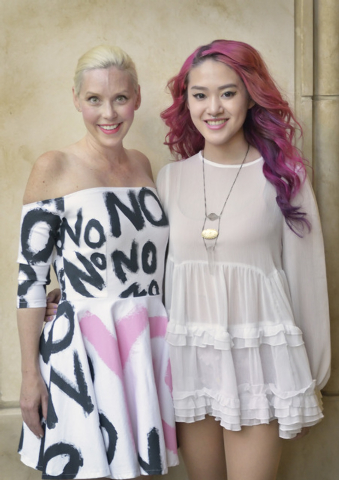 Huilin Chen, right, stands with model Shannon D'Errico, who is wearing one of Chen's outfits. (Bill Hughes/View)