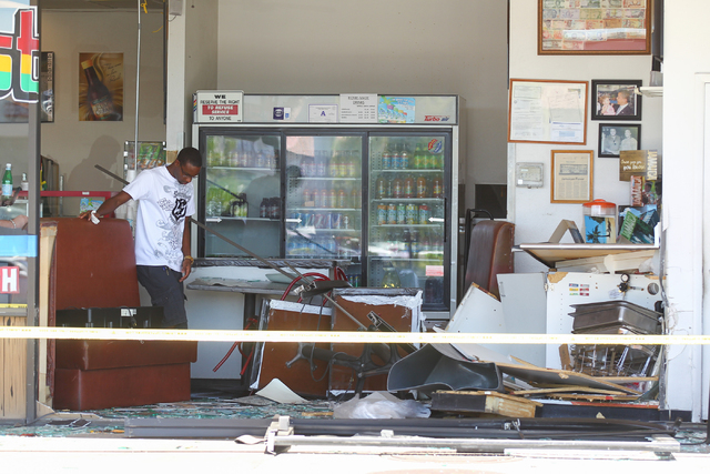 Restaurant owner Kahiel Easy surveys damage from an SUV crash at Tasty Island Jamaican Restaurant, 6820 W. Flamingo Road, in Las Vegas on Wednesday, Sept. 24, 2014. The crash occurred at around 9: ...
