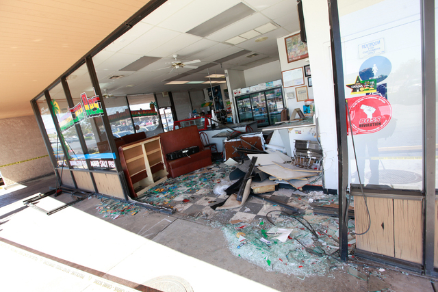Damage from an SUV crash is seen at Tasty Island Jamaican Restaurant, 6820 W. Flamingo Road, in Las Vegas on Wednesday, Sept. 24, 2014. The crash occurred at around 9:30 a.m. before the restaurant ...