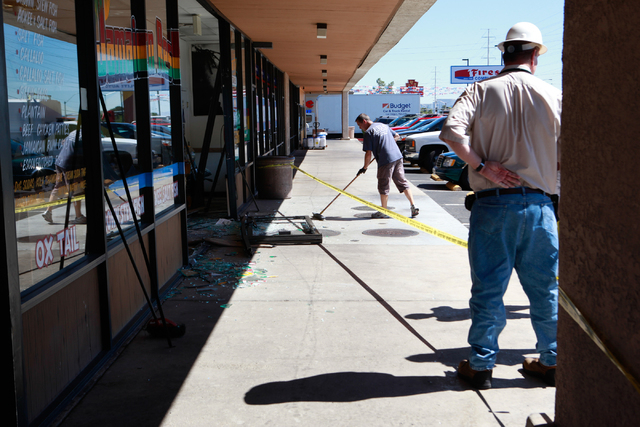 Cleanup of damage from an SUV crash goes on at Tasty Island Jamaican Restaurant, 6820 W. Flamingo Road, in Las Vegas on Wednesday, Sept. 24, 2014. The crash occurred at around 9:30 a.m. before the ...