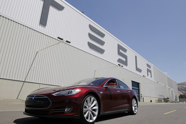 This June 22, 2012 file photo shows a Tesla Model S outside the Tesla factory in Fremont, Calif. On Wednesday, Nov. 13, 2013. (AP Photo/Paul Sakuma, File)