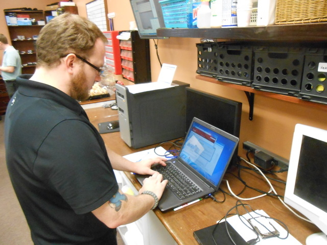 Michael Valenti, a student at ITT Technical Institute, works on a computer July 15 at TLC Computer Solutions, 7501 W. Lake Mead Blvd., Suite 112, as part of the shop's internship program. (Jan H ...