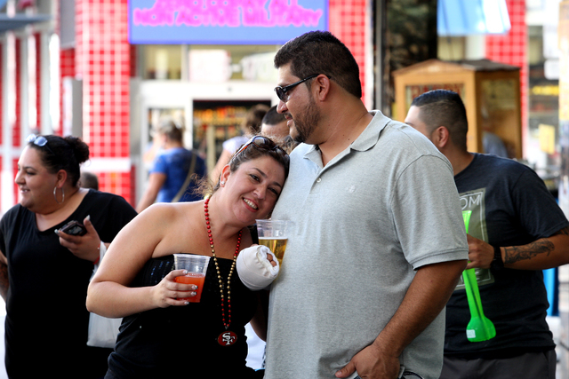 Lin Sanchez and Humberto De La Cruz from Arizona gather with friends at the Fremont Street Experience in Las Vegas, Nevada on Friday, September 26, 2014. (Michael Quine/Las Vegas Review-Journal)