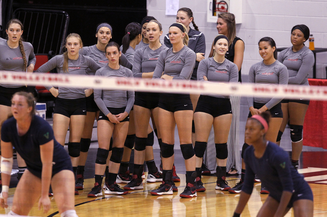 Members of the UNLV women's volleyball team check out the competition before taking on Fresno State at Cox Pavilion in Las Vegas Thursday, Sept. 25, 2014. UNLV went on to beat Fresno State 3-0. (K ...