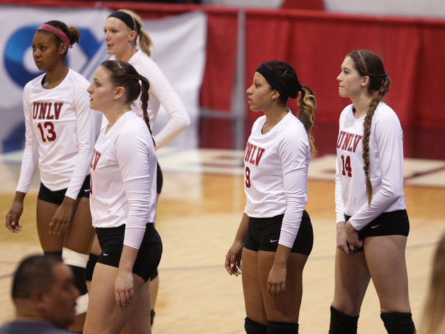 Members of the UNLV women's volleyball team, from left, Daryn Glenn (13), Katlin Winters (11), Alyssa Wing, Bree Hammel (9) and Ashley Owens prepare to take onFresno State at Cox Pavilion in Las V ...