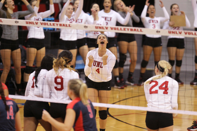 Alexis Patterson (4) and other members of the UNLV women's volleyball team celebrate winning a long rally in the first set against Fresno State at Cox Pavilion in Las Vegas Thursday, Sept. 25, 201 ...
