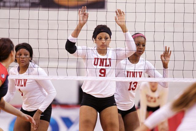 UNLV's Bree Hammel signals to her teammates, including Ceannia Kincade (1) and Daryn Glenn (13) during the second set of a volleyball game against Fresno State at Cox Pavilion in Las Vegas Thursda ...