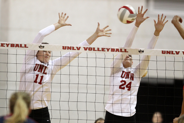 UNLV's Katlin Winters (11) and Alyssa Wing (24) go up for a block against Fresno State in the second set of a volleyball game at Cox Pavilion in Las Vegas Thursday, Sept. 25, 2014. UNLV went on to ...