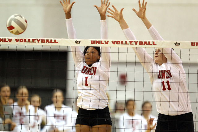 UNLV's Ceannia Kincade (1) and Katlin Winters (11) go up for a block against Fresno State in the third set of a volleyball game at Cox Pavilion in Las Vegas Thursday, Sept. 25, 2014. UNLV went on  ...