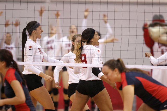 Bree Hammel (9), Alexis Patterson (4) and the rest of the UNLV women's volleyball team celebrate beating Fresno State 3-0 at Cox Pavilion in Las Vegas Thursday, Sept. 25, 2014. (K.M. Cannon/Las Ve ...