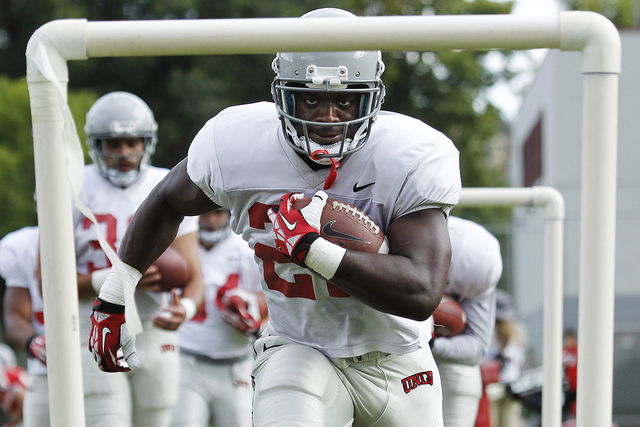 Running back David Greene (22) runs a drill during the opening day of UNLV's training camp up in Ely on Aug. 10, 2014. (Jason Bean/Las Vegas Review-Journal)