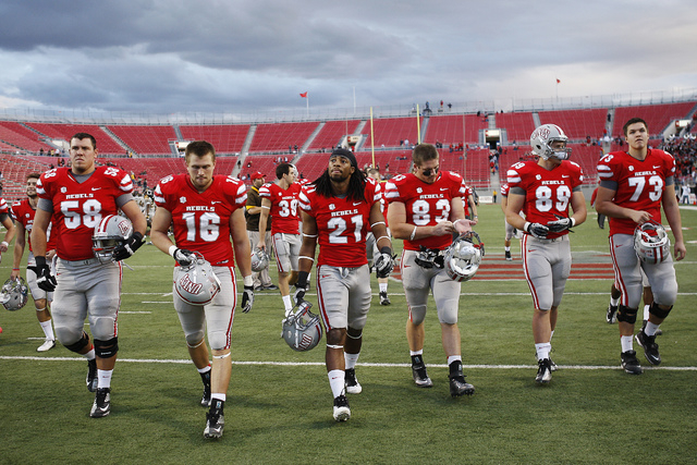 UNLV Rebels players walk off the field after losing 28-23 to the Wyoming Cowboys in a NCAA -- Mountain West Conference football game at Sam Boyd Stadium in Las Vegas, Nov. 17, 2012. (Jason Bean/La ...