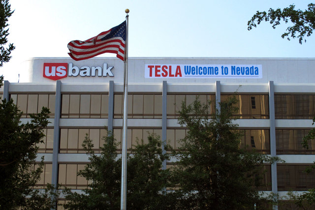 A banner welcoming Tesla to Nevada is hung on the US Bank building just south of the downtown Reno casino district on Tuesday, Sept. 9, 2014. State lawmakers are meeting in a special legislative s ...