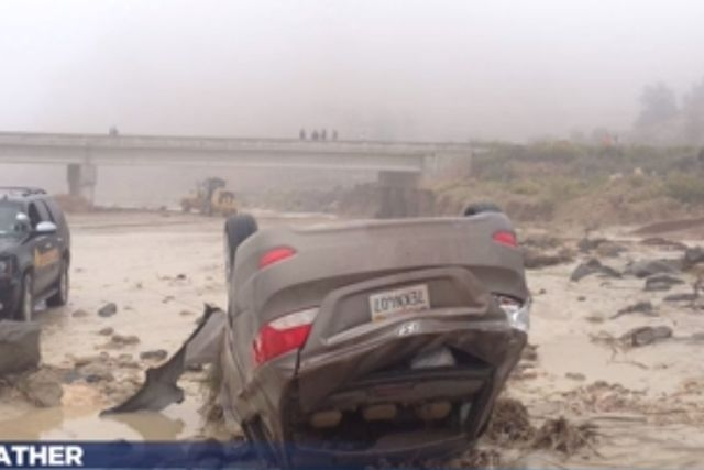 An Italian couple were rescued after their car plunged into a So. Utah river on Saturday, Sept. 27, 2014, when flooding caused the road around them to collapse. (Screen grab, KSL-TV)