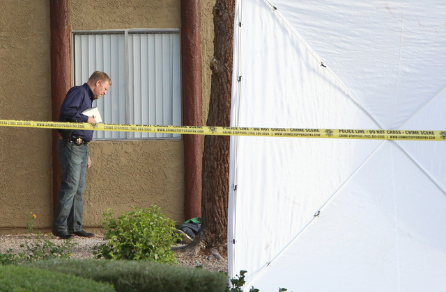 Las Vegas homicide detective investigates a fatal shooting on Thursday, Sept. 18, 2014, at Andiamo Apartments in the 4600 block of Vegas Drive, near Decatur Boulevard. Police said one man is dead  ...