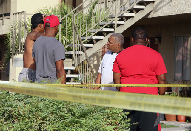 Andiamo Apartments residents gather near where Las Vegas police are investigating a fatal shooting on Thursday, Sept. 18, 2014, in the 4600 block of Vegas Drive, near Decatur Boulevard. Police sai ...