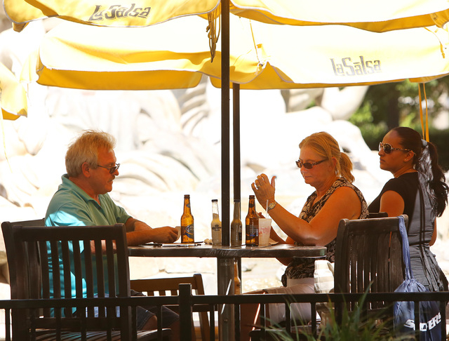 Tourists enjoy their time as they sit at LaSalsa, Mexican Restaurant and Bar, near Caesars Palace Hotel & Casino on Las Vegas Boulevard on Friday, Sept. 26, 2014, in Las Vegas. (Bizu Tesfaye/Las V ...