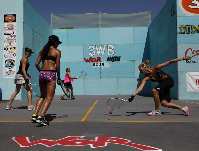Rhonda Rajsich, right, misses a shot during the women's open 3 wall racquetball championships at the 3 Wallball World Championship across from the Stratosphere in Las Vegas on Sunday, Sept. 14, 20 ...