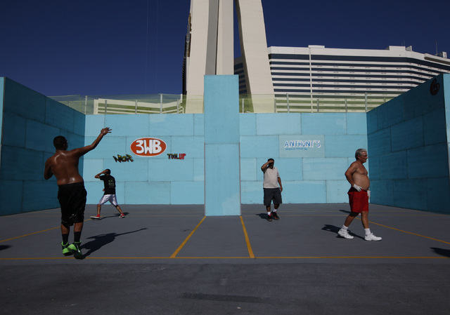 Competitors play handball at the 3 Wallball World Championship across from the Stratosphere in Las Vegas on Sunday, Sept. 14, 2014. The tournament brought 600 competitors and 1100 matches during i ...