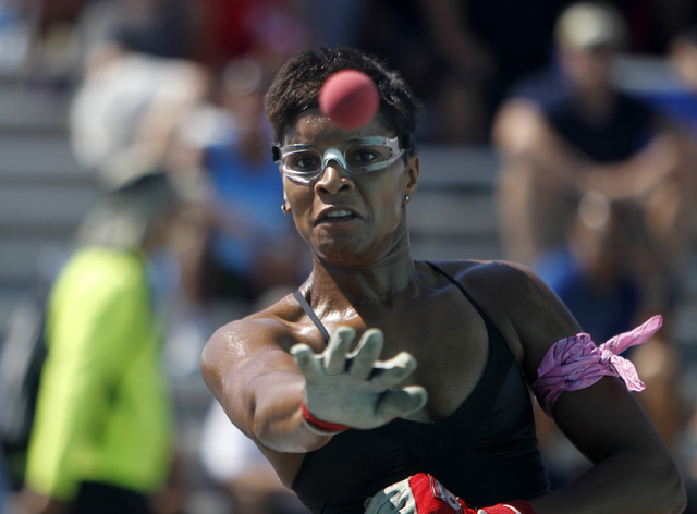 Tracy Davis, of Brooklyn, New York, hits the ball during her 3 wall handball championship match at the 3 Wallball World Championship across from the Stratosphere in Las Vegas on Sunday, Sept. 14,  ...