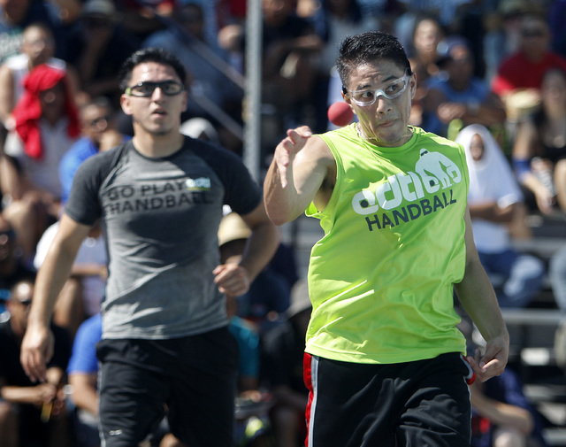 Juan Santos, of Orange County, Calif., right, hits the ball against Ricardo Ruiz during their 3 wall handball championship match at the 3 Wallball World Championship across from the Stratosphere i ...