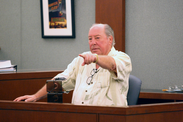 At preliminary hearing before Judge Diana L. Sullivan on Wednesday, September 24, 2014, Kenneth Herold points to Christina Lafave, the woman charged for the theft of his gold Presidential Rolex wa ...