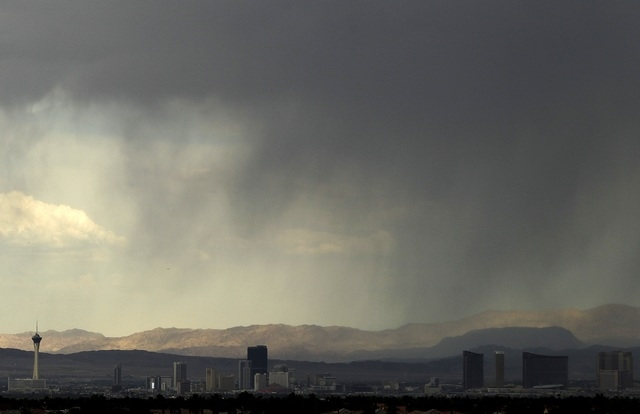 Rain falls on Las Vegas in July. A three-day flash flood warning has been issued for the Las Vegas Valley starting Sunday. (Justin Yurkanin/Las Vegas Review-Journal)