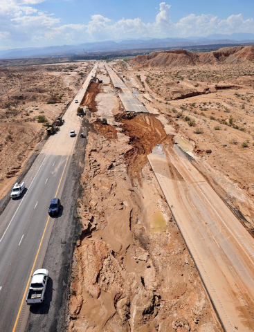 Road crews work to repair Interstate 15 in Moapa on Tuesday, Sept. 9, 2014. Record flooding on Monday, Sept. 8, caused major highway damage.  (Photo by David Becker/Las Vegas Review-Journal)