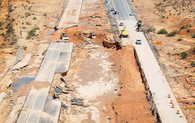 Road crews work to repair Interstate 15 in Moapa on Tuesday, Sept. 9, 2014. Record flooding on Monday caused major highway damage.  (Photo by David Becker/Las Vegas Review-Journal)