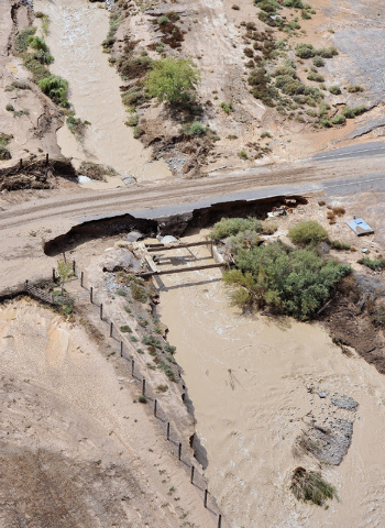 Muddy water continue to flow in creeks in Moapa on Tuesday, Sept. 9, 2014. Heavy rains created flooding throughout the community and damaged a large section of Interstate 15. (Photo by David Becke ...