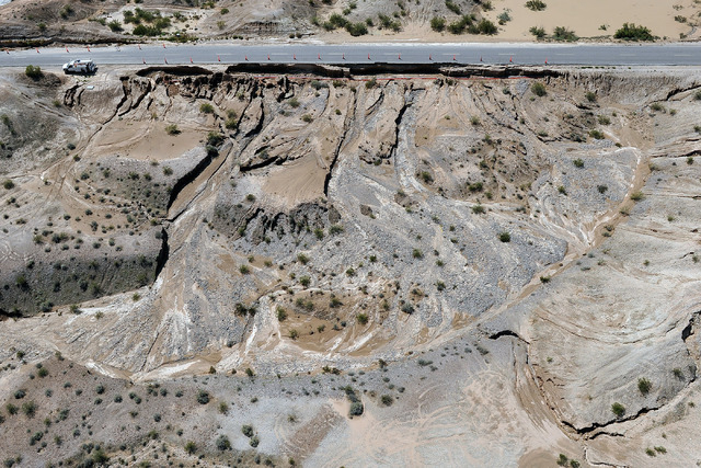 Road damage created by flooding is seen in Moapa on Tuesday, Sept. 9, 2014. Heavy rains created flooding throughout the community and damaged roads including a large section of Interstate 15. (Pho ...