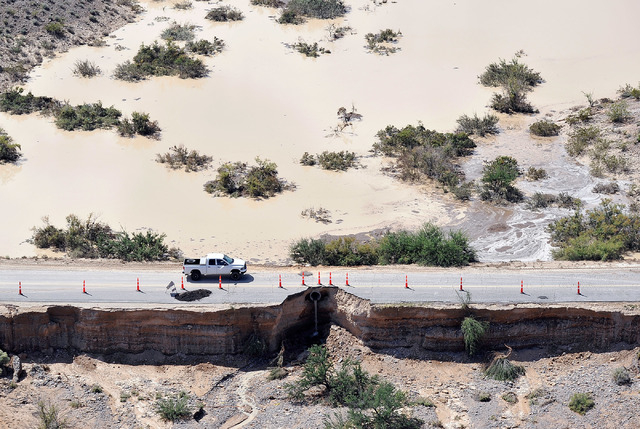 Road damage created by flooding is seen in Moapa on Sept. 9, 2014. Heavy rains created flooding throughout the community and damaged roads including a large section of Interstate 15. (Photo by Dav ...