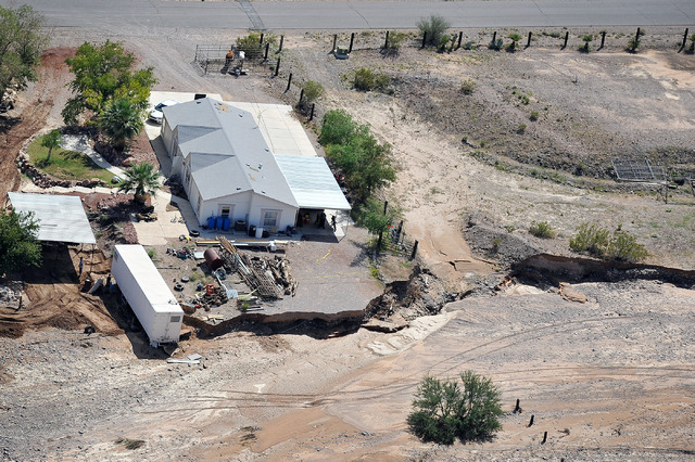 Remnants of flood waters are seen near homes in Moapa on Tuesday, Sept. 9, 2014. Clark County commissioners approved a disaster declaration Tuesday, Sept., 16, following the flash floods that wash ...
