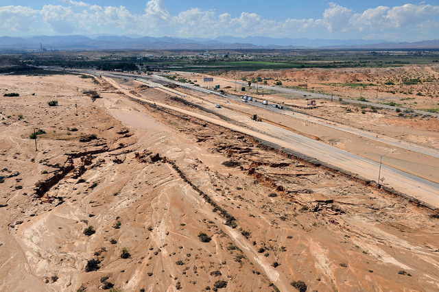 A overall view of flooding damage is seen of along Interstate 15 just north of the Moapa interchange on Tuesday, Sept. 9, 2014. Record flooding on Monday caused major damage shutting down the high ...