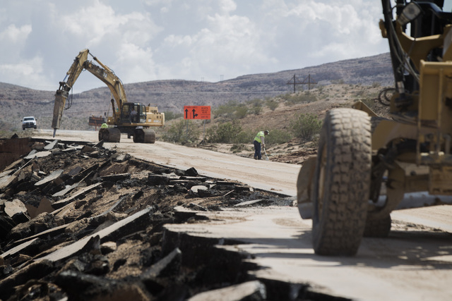 Road crews repair damage on  I-15  north of Glendale, Nev., on Tuesday, Sept. 9, 2014. A Monday afternoon rain storm caused heavy damaged 1-15 near Glendale. The major north-south interstate could ...