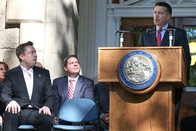 """Welcome to your new home, Mr. Musk!"" says Gov. Brian Sandoval, outside Nevada's state capitol."
