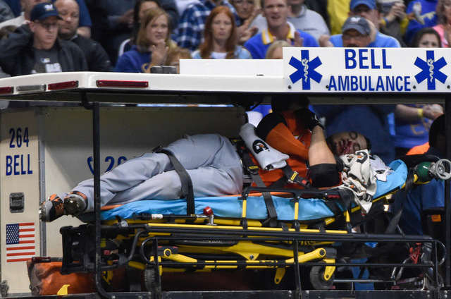 Miami Marlins right fielder Giancarlo Stanton (27) is carted off the field after getting hit by a pitch in the fifth inning against the Milwaukee Brewers at Miller Park. (Benny Sieu/USA TODAY Sports)