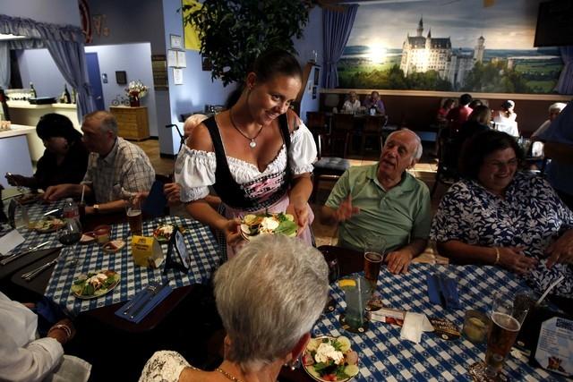 Nicole Kasiske serves diners at the Bavarian Castle restaurant in Henderson on Sunday, Sept. 14, 2014. (Justin Yurkanin/Las Vegas Review-Journal)