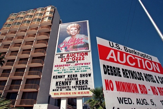 A sign outside the Debbie Reynolds hotel-casino in Las Vegas, Wednesday, Aug. 5, 1998, posts a bankruptcy auction of the property. The property was reportedly purchases for $9 million by a group r ...