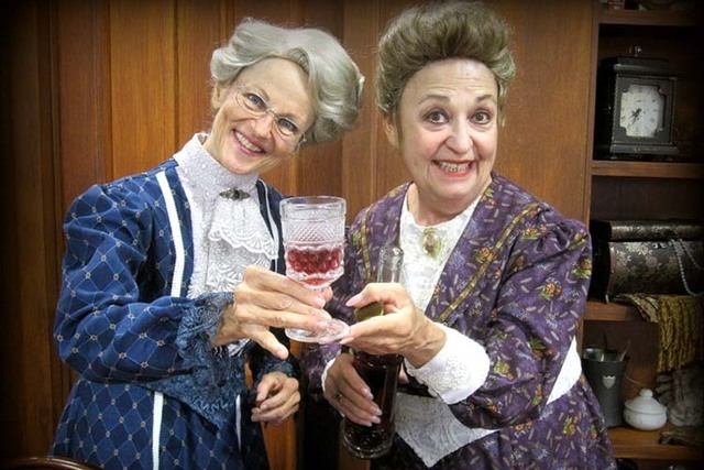 """The Brewster sisters, spinsters Martha (Mary Alice Burack) and Abby (Andee Gibbs), offer unsuspecting guests a sip of homemade -- and decidedly deadly -- elderberry wine in """"Arsenic and Old Lace,"""" ..."""