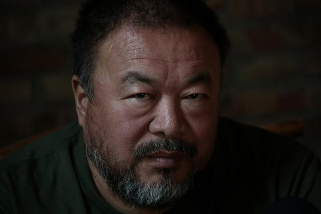 Dissedent Chinese artist Ai Weiwei looks up during a group interview at his studio in Beijing, May 22, 2013. (REUTERS/Petar Kujundzic)