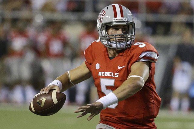 UNLV quarterback Blake Decker (5) prepares to pass against Northern Colorado in an NCAA football game Saturday, Sept. 6, 2014, in Las Vegas. (AP Photo/John Locher)