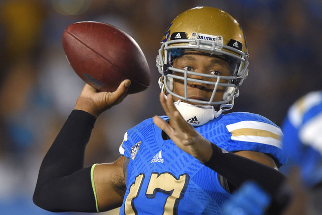 UCLA quarterback Brett Hundley passes the ball during the first half of an NCAA college football game against Memphis, Saturday, Sept. 6, 2014, in Pasadena, Calif. (AP Photo/Mark J. Terrill)